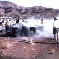 Workers shovel raw blue asbestos tailings into drums at an asbestos shovelling competition at Wittenoom in 1962.